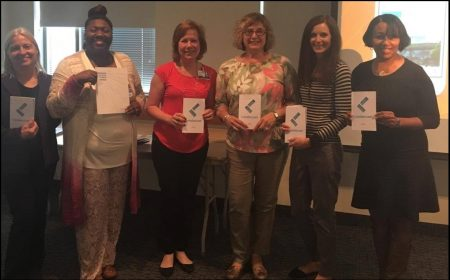 Holding their Leadercast programs are from left, Anita Mattero (Sibley Core Lab Manager), Tabitha Little-Baker (Suburban Hospital Hematology Technical Specialist), Debbie Aird, Marie Moninger (Suburban Hospital Core Lab Manager), Chris Calvelli (Suburban Hospital QA Coordinator), and Arneal Crocker (Transfusion Medicine Manager, Suburban and Sibley Hospitals).